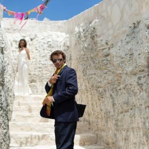 Bajacu Bohemian groom in rock stairwell