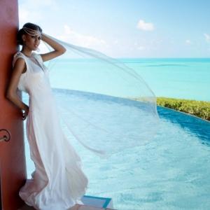 Bajacu Bohemian bridal satin gown by infinity pool
