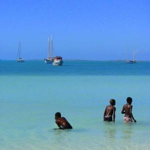 Boys and boats in Sopadilla Bay