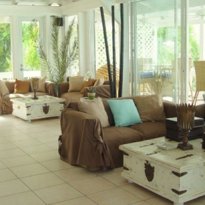 Coffee table rolling trunks furniture distress at Bay Bistro