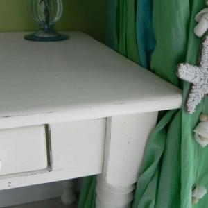 Slight distress of refinished dark wood desk