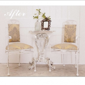Antique arm chairs and side table after