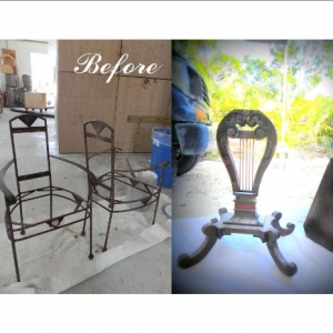 Antique metal chairs and harp shaped side table before