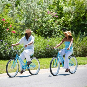 Resort couple on bicycle ride