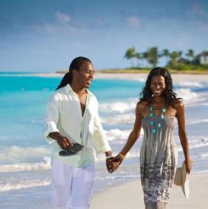 Resort couple beach walk