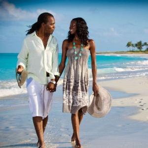 Resort couple beach stroll