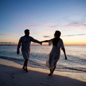 Resort couple sunset silhouette