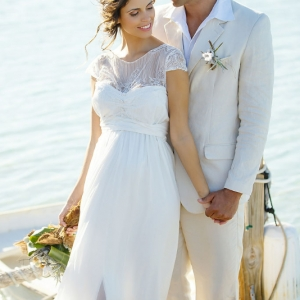 Well Read Rustic Wedding Styled Shoot Rowboat Couple
