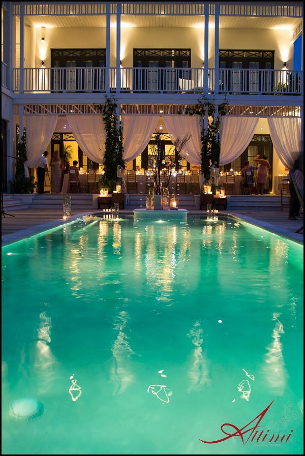Melissa and Joe's wedding at Saving Grace Villa, poolside reception with beautiful draping