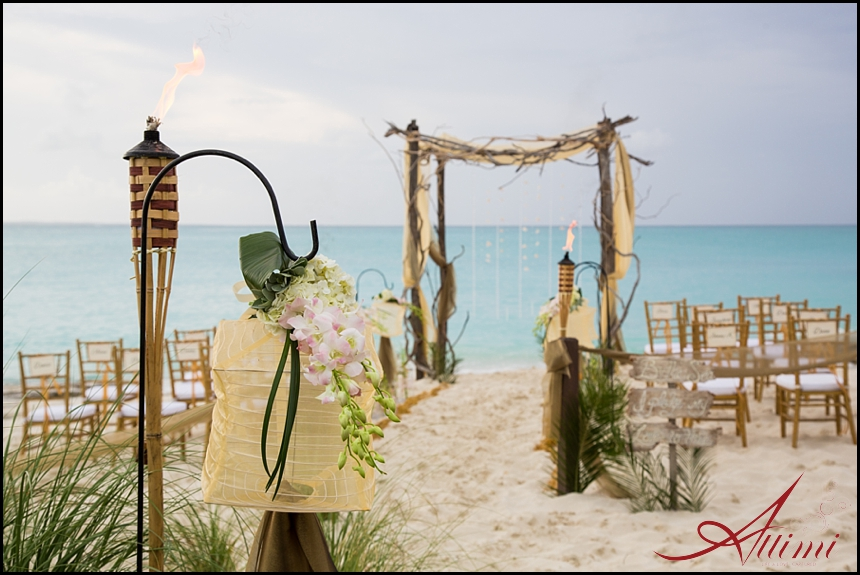 Melissa and Joe's wedding at Saving Grace Villa, driftwood chuppah on the beach gold palette